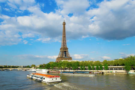 View of the Eiffel tower with touristic boat on Seine photo