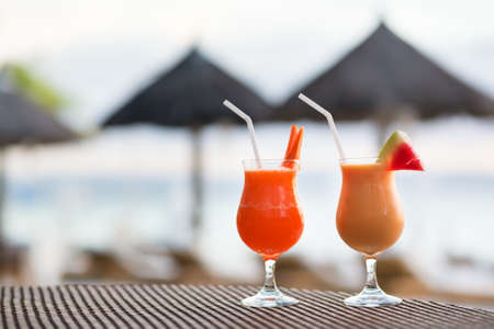 Two fresh juices on a tropical beach photo