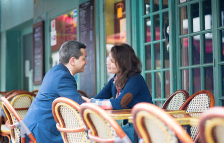 Couple discussing something in an outdoor restaurant photo