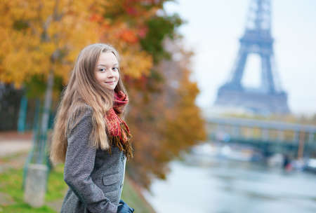 Beautiful young lady on a fall day in Paris photo