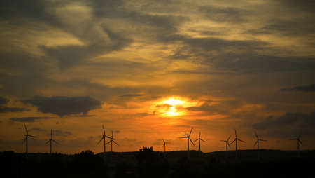Wind farms against the sunset photo