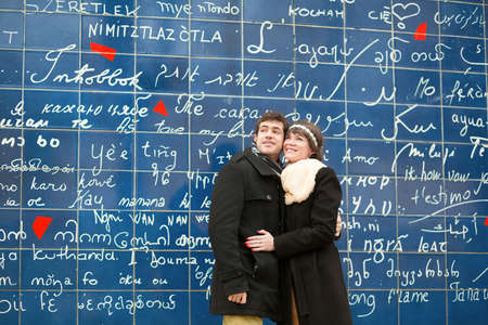 I T: Happy couple against the I love you wall Stock Photo