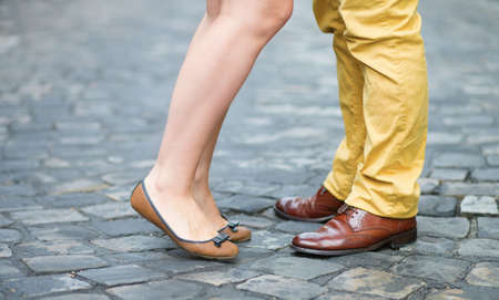 Closeup of male and female legs during a date photo