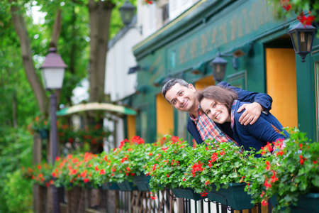 Couple on balcony with blossoming geranium photo