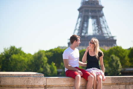 Young couple with the Eiffel tower in the background photo