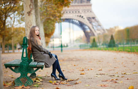Beautiful girl in Paris on a fall day photo