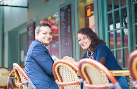 Cheerful couple in an outdoor cafe photo