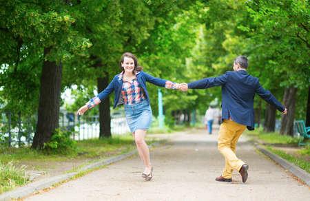 Couple having fun in a park photo
