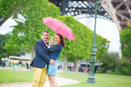 Couple under the red umbrella in Paris photo