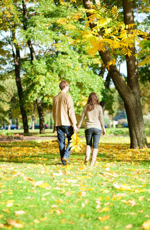 Couple walking in park on a fall day photo