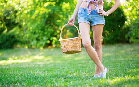 Young girl with basket going to have a picnic photo