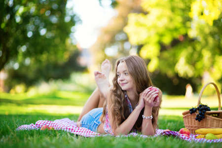 Beautiful girl on a picnic in park photo