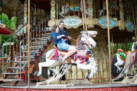 carousel horse: Couple having fun on merry-go-round