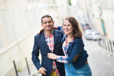 Happy loving couple on a Parisian street photo