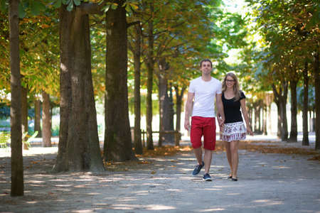 Couple in the Tuileries garden on summer or fall day photo