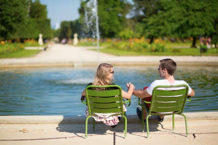 Couple relaxing in the Tuileries garden of Paris photo