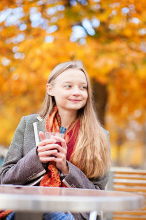 Girl drinking hot wine in a cafe Stock Photo - 21435548