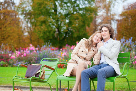 Romantic couple in a park, having a date photo