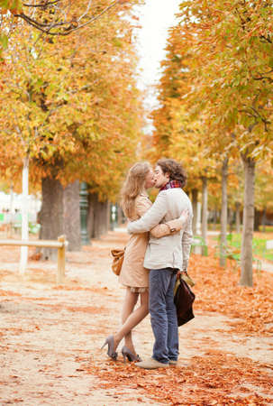 Dating couple in Paris on a fall day photo