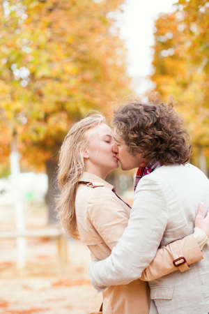 Romantic couple kissing on a fall day photo