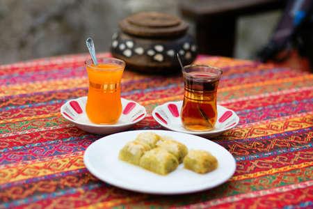 baklawa: Orange and apple Turkish tea served with baklawa