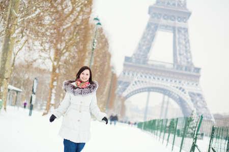 'tour eiffel': Girl enjoying beautiful winter day in Paris