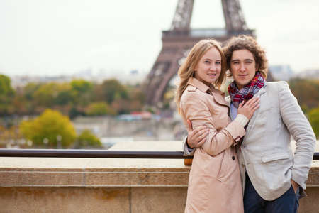 Happy couple spending their vacation or honeymoon in Paris photo