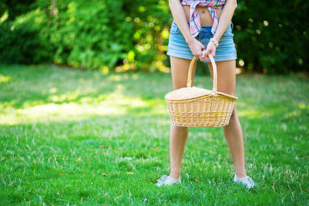 Young girl holding picnic basket photo