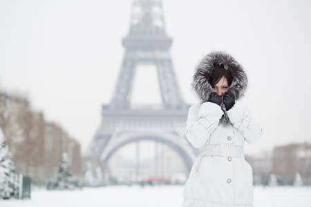 Beautiful young woman in Paris on a winter day photo