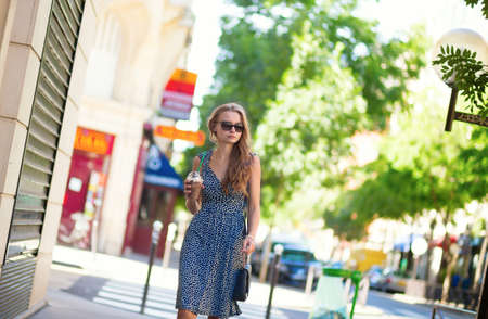 Beautiful young woman with mobile phone in the street Stock Photo