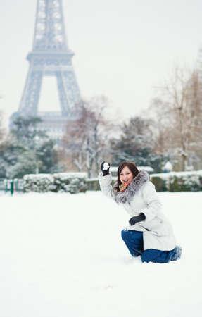 parisian scene: Girl playing snowballs in Paris