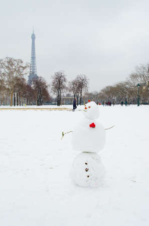 Funny snowman on a Parisian street photo