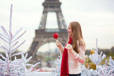 Girl with caramel apple in Paris photo