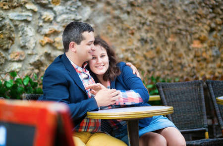 Dating couple in an outdoor Parisian cafe photo