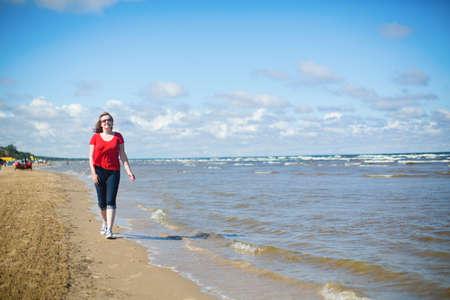 jurmala: Girl walking near the sea in Jurmala, Latvia