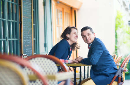 Couple in an outdoor Parisian restaurant photo