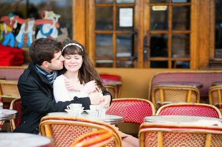 Dating couple kissing in a cafe photo