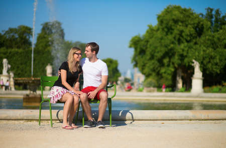 Dating couple in the Tuileries garden of Paris