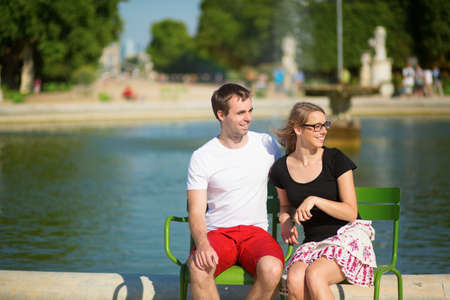 Dating couple in the Tuileries garden of Paris photo