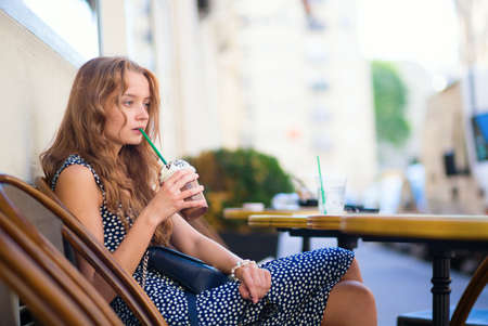Thoughtful girl drinking a beverage photo