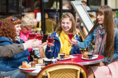 Beautiful girls in a Parisian cafe photo