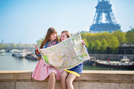 Two girls looking for direction in Paris. photo