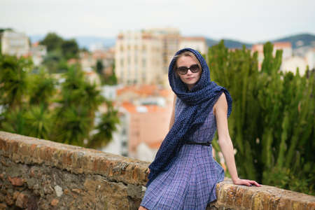 Elegant young woman in the Old town of Cannes, France photo