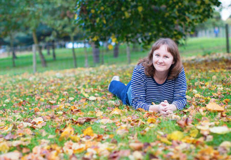 jardin de luxembourg: Girl enjoying bright fall day in a park Stock Photo