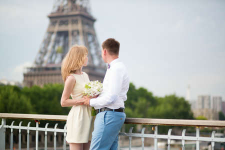 Just married couple in Paris near the Eiffel tower photo
