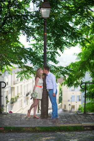 Happy just married couple on Montmarte in Paris photo