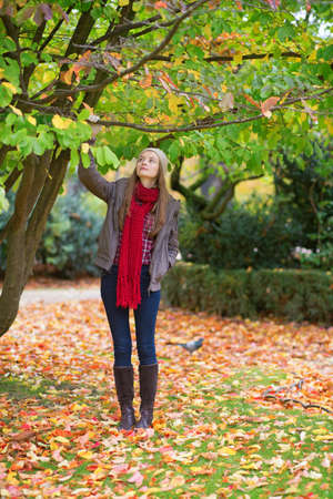 Young girl walking in park on a fall day Stock Photo - 30082027