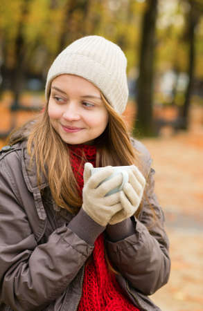 Girl drinking coffee in an outdoor Parisian cafe on a fall day Stock Photo - 30082029
