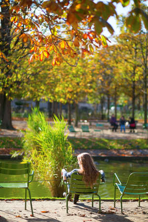 Girl in the Gardens of Luxembourg of Paris on a fall day Stock Photo - 30082032