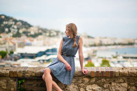 Young girl looking at the city of Cannes from Le Suquet hill photo